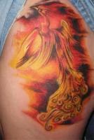 тату огненный феникс на ноге