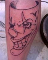 Тату улыбающаяся маска клоуна