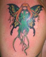 Тату фея в зеленом платье