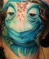 Тату черепаха с зелеными глазами