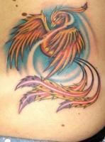 тату красный феникс на груди слева