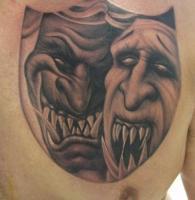 Тату две маски на груди